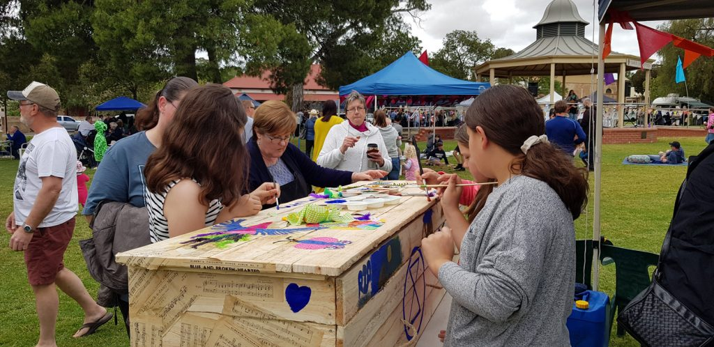 All ages stopped to decorate the eco coffin