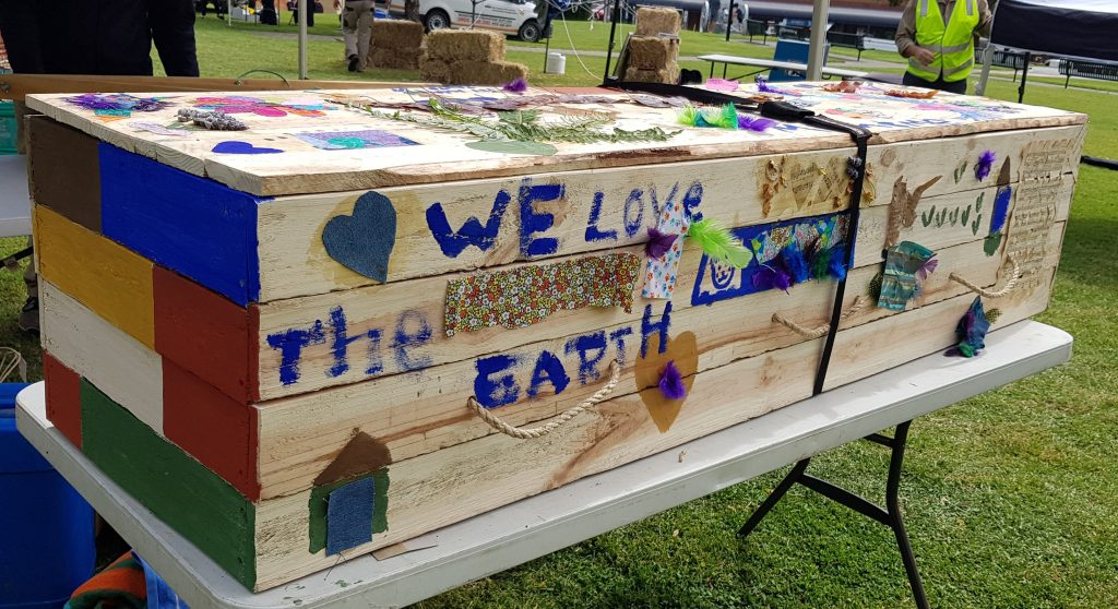 A collective collaboration of love decorating the eco coffin