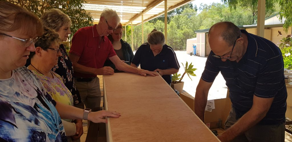 Assembling coffin-in-a-box for the Eco Coffin Project